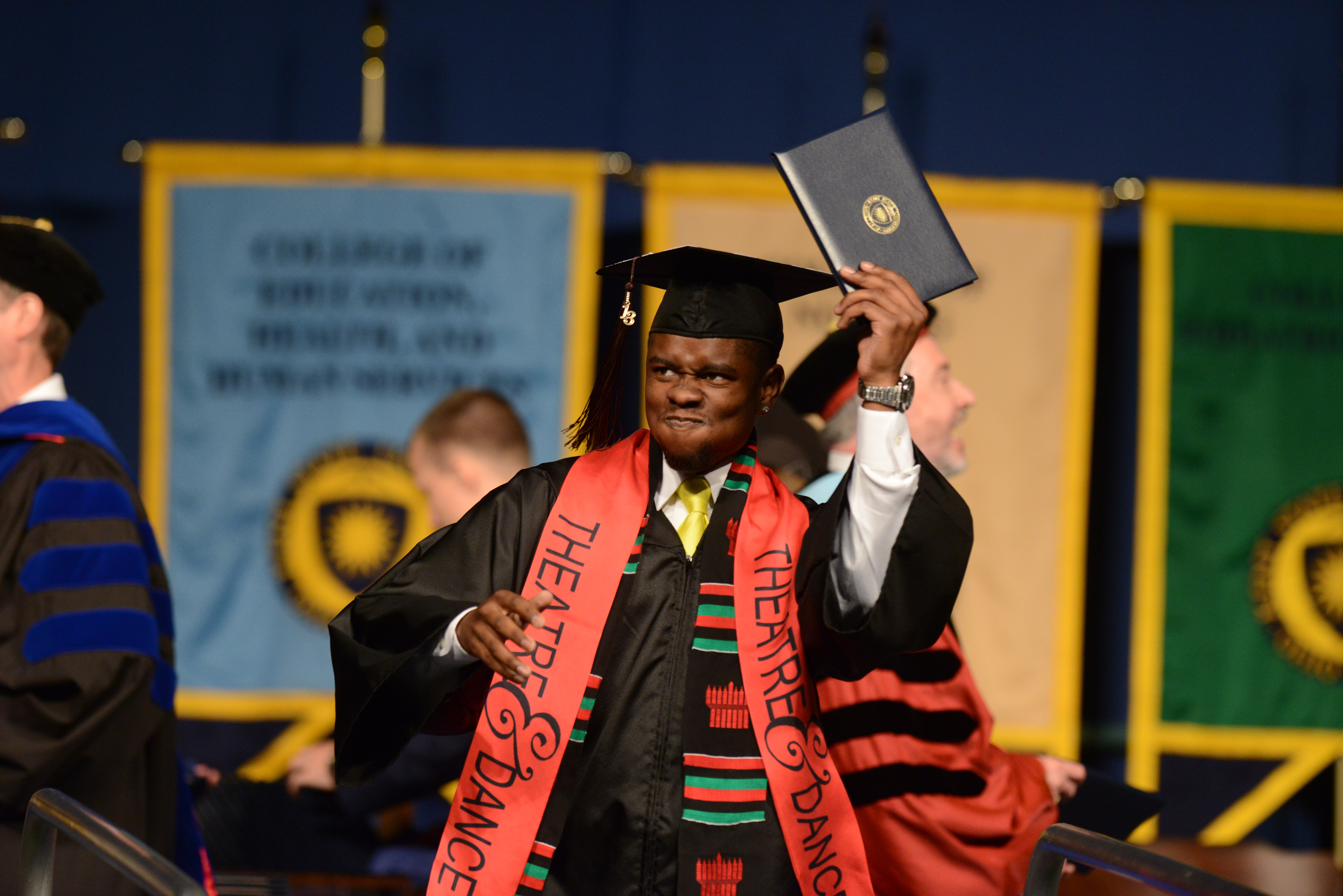 A Theatre student celebrates at Kent State commencement.