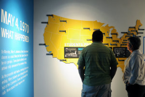 Visitors to the May 4th Visitor Center in Taylor Hall, look at a time line of events that lead to the shootings at Kent State on May 4, 1970.