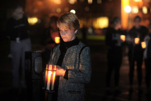 Dr. Beverly Warren stands vigil on the spot where Allison Krause was shot during the May 4, 1970 shootings during the Spring 2015 Candlelight Vigil.