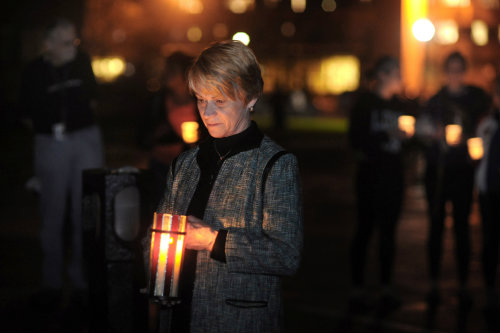 Kent State president Beverly Warren holds a vigil