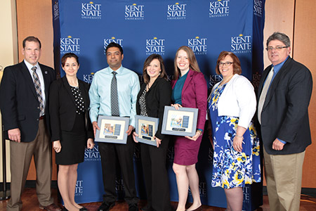 Shay Little and Greg Jarvie pose with the winners of the 2017 Greg Jarvie Students First Award. Pictured (from left) are Chris Jenkins, Nichole DeCaprio, Sameer Jaleel, Janet Schramm, Kjera Seregi, Shay Little and Greg Jarvie. Award winner Paul Gaston is not pictured.