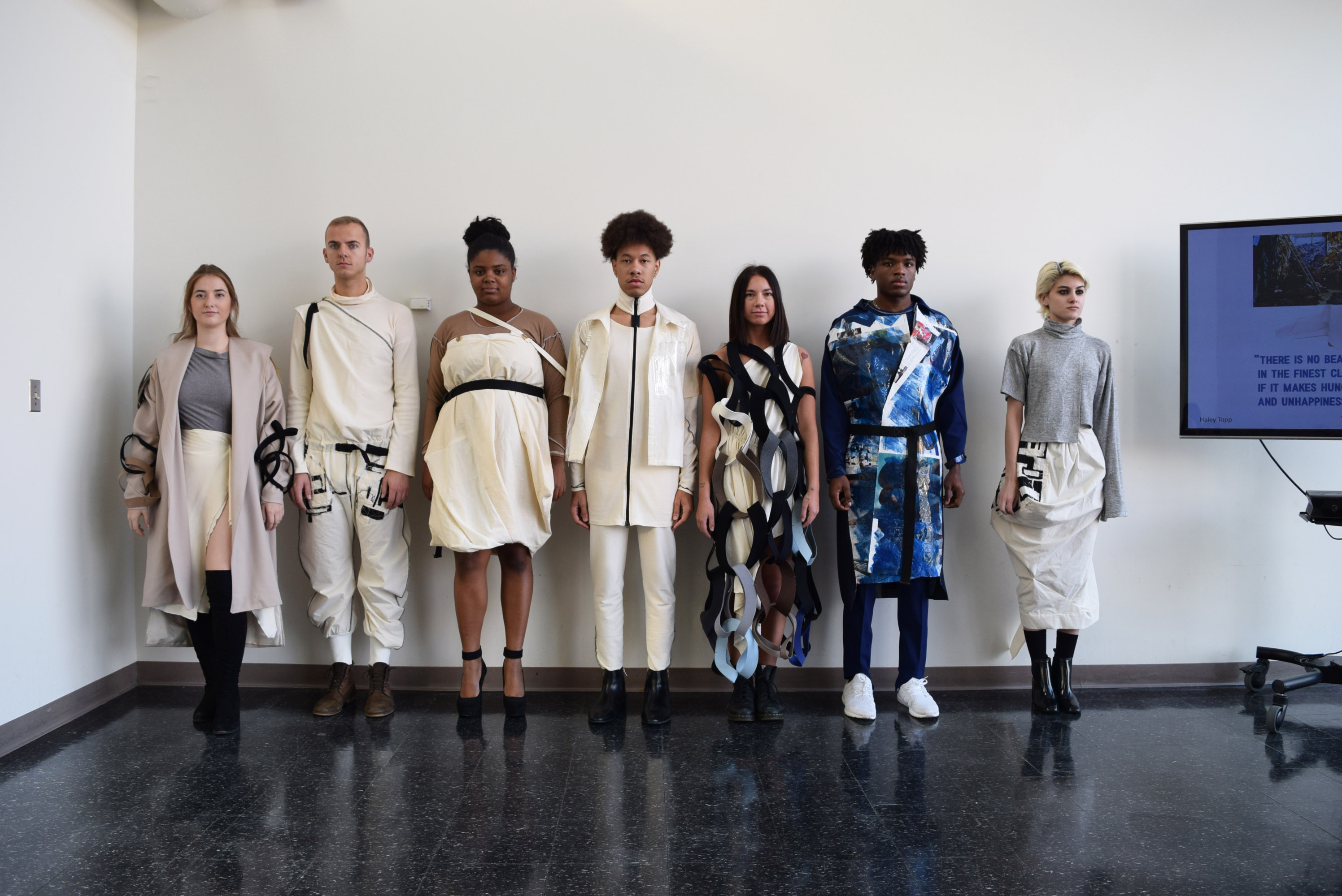 Students modeling muslins during 2018 BFA Muslin Critiques