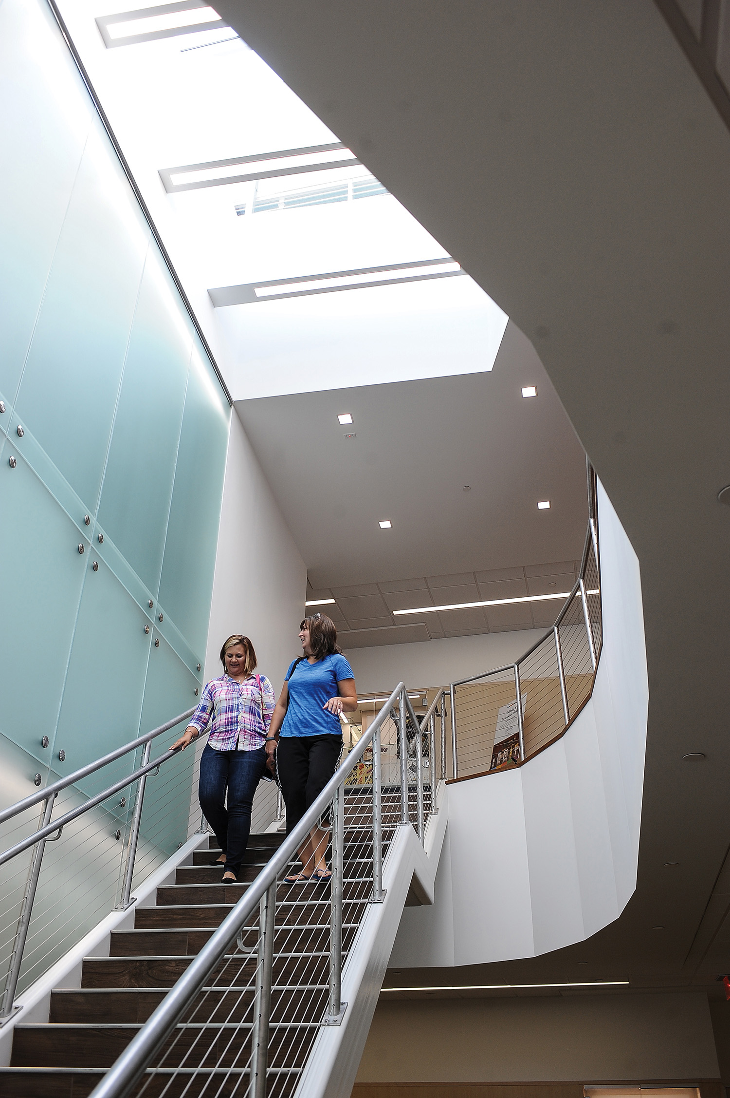 Faculty walk through the stairwell in the Science and Nursing building at Kent State University at Stark