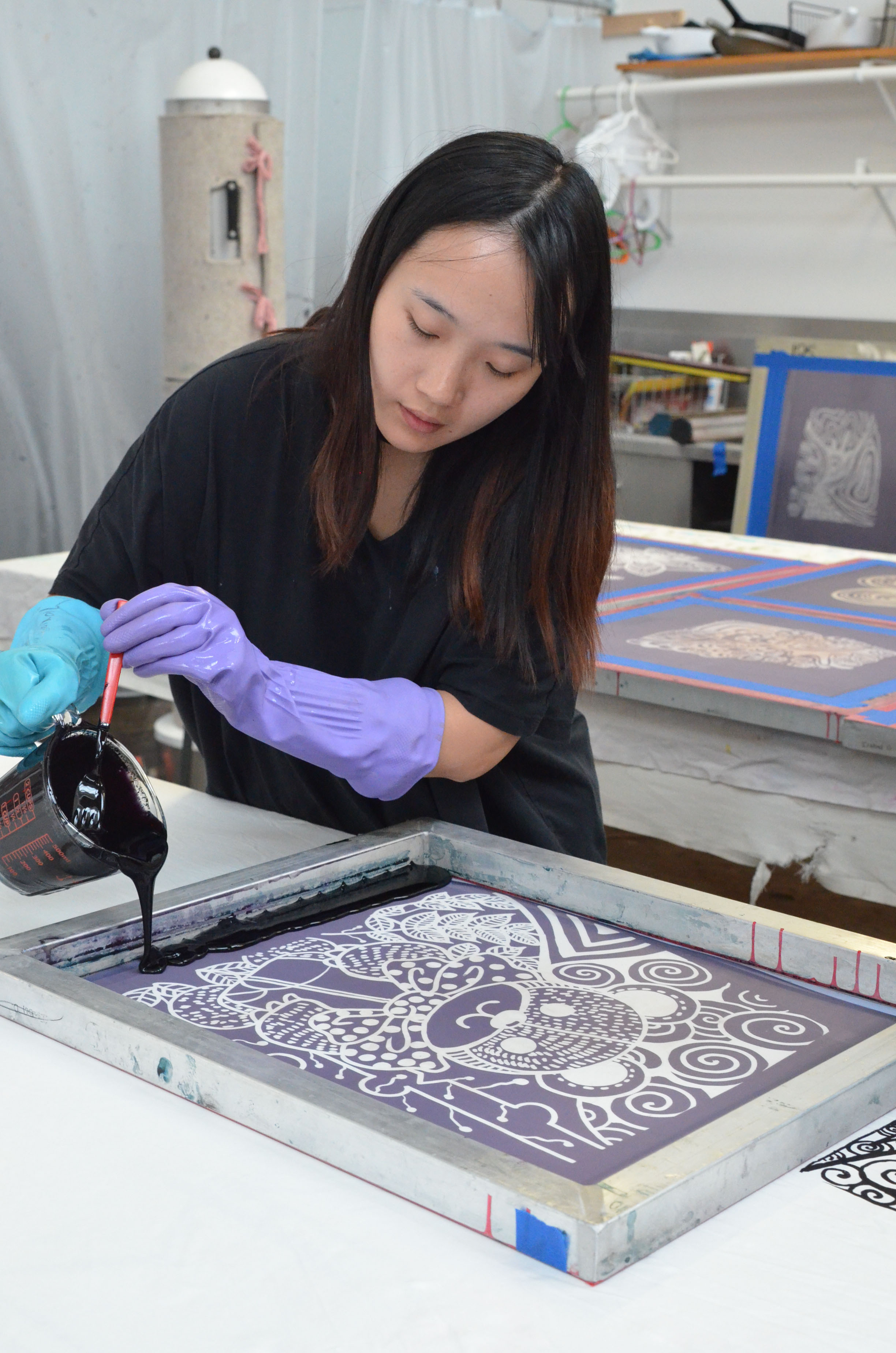 """Supima Design Competion finalist Shuxian Kong works on her collection """"Doodling Childhood."""""""