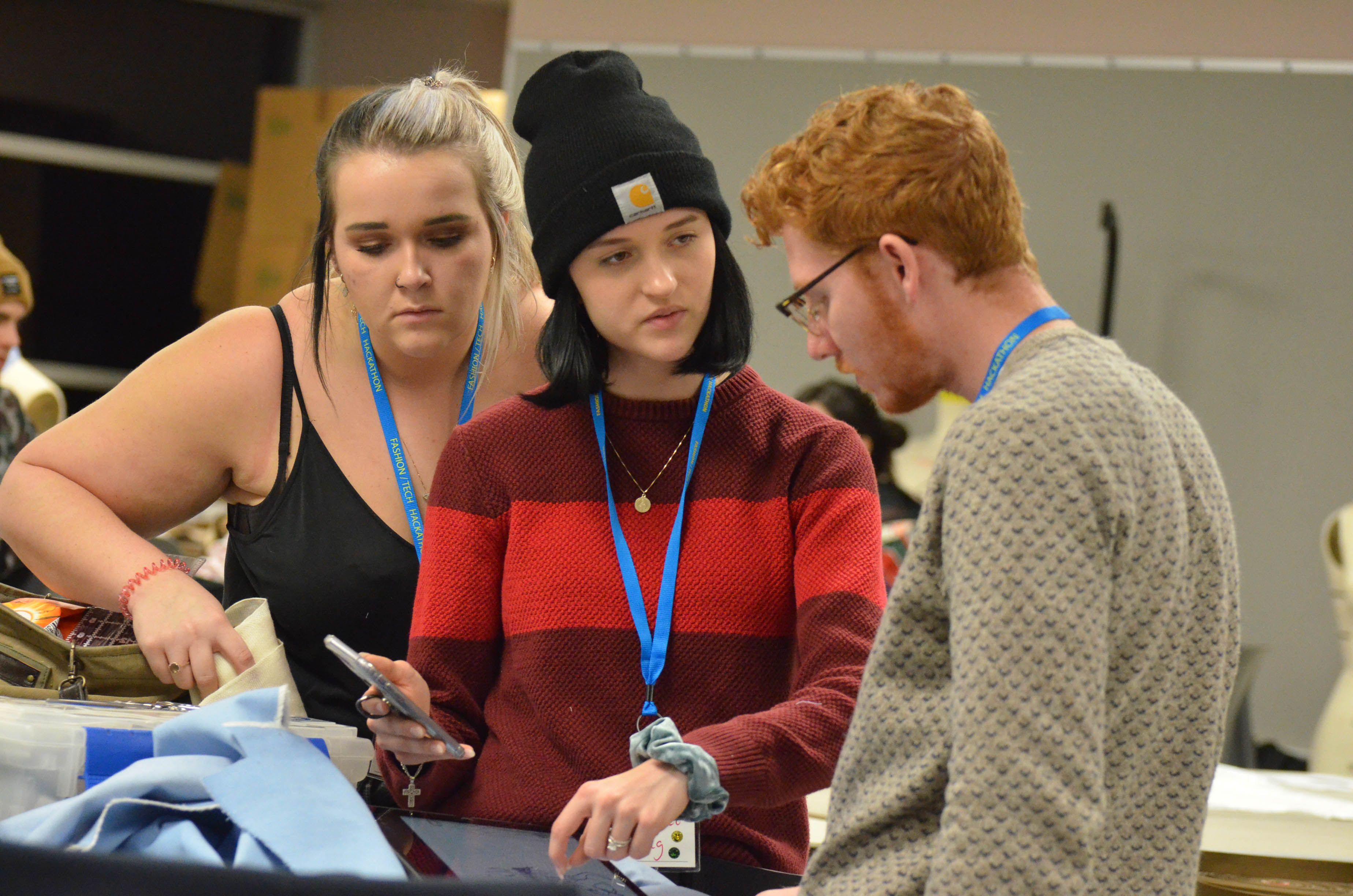 Students work during the first night of the Fashion Tech Hackathon