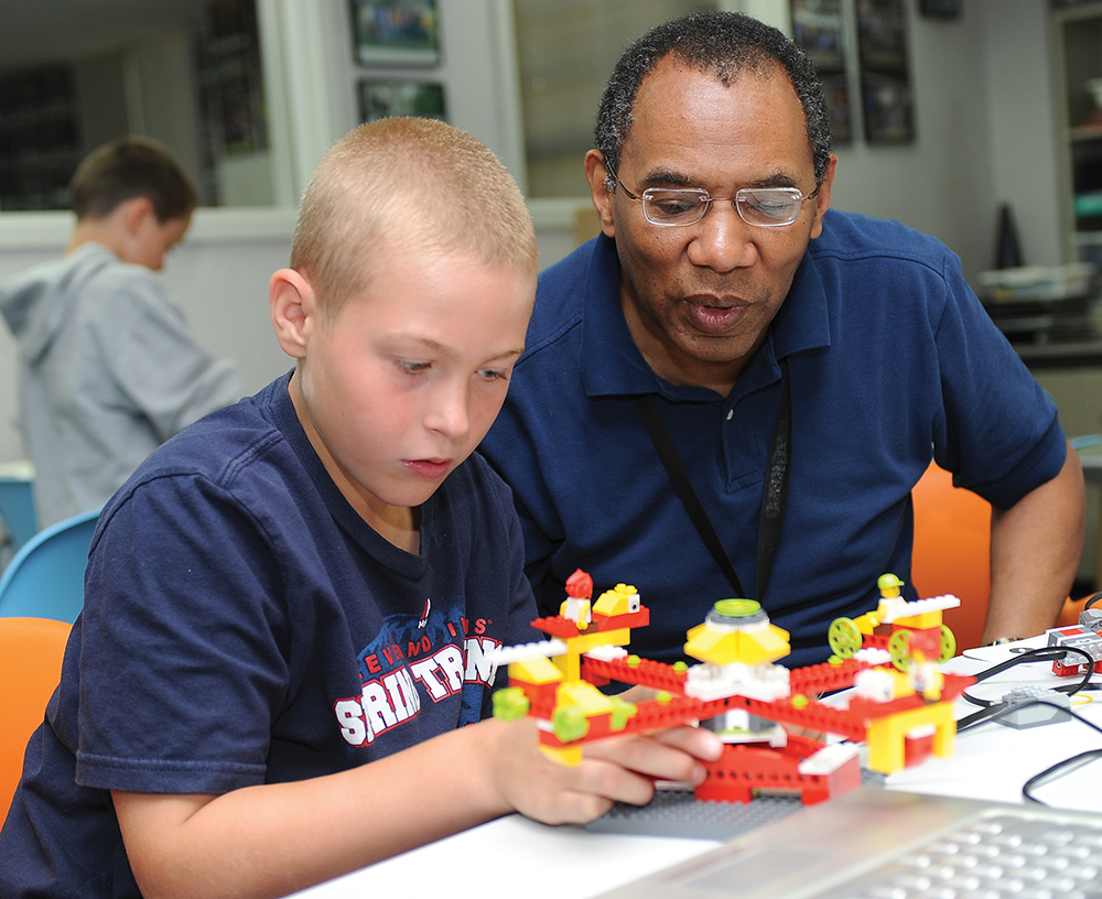 With the support and training of Thomas McNeal, the technology director for the AT&T Classroom, children at the summer technology camps work on a new project each day, building LEGO models of their choice and making them move.
