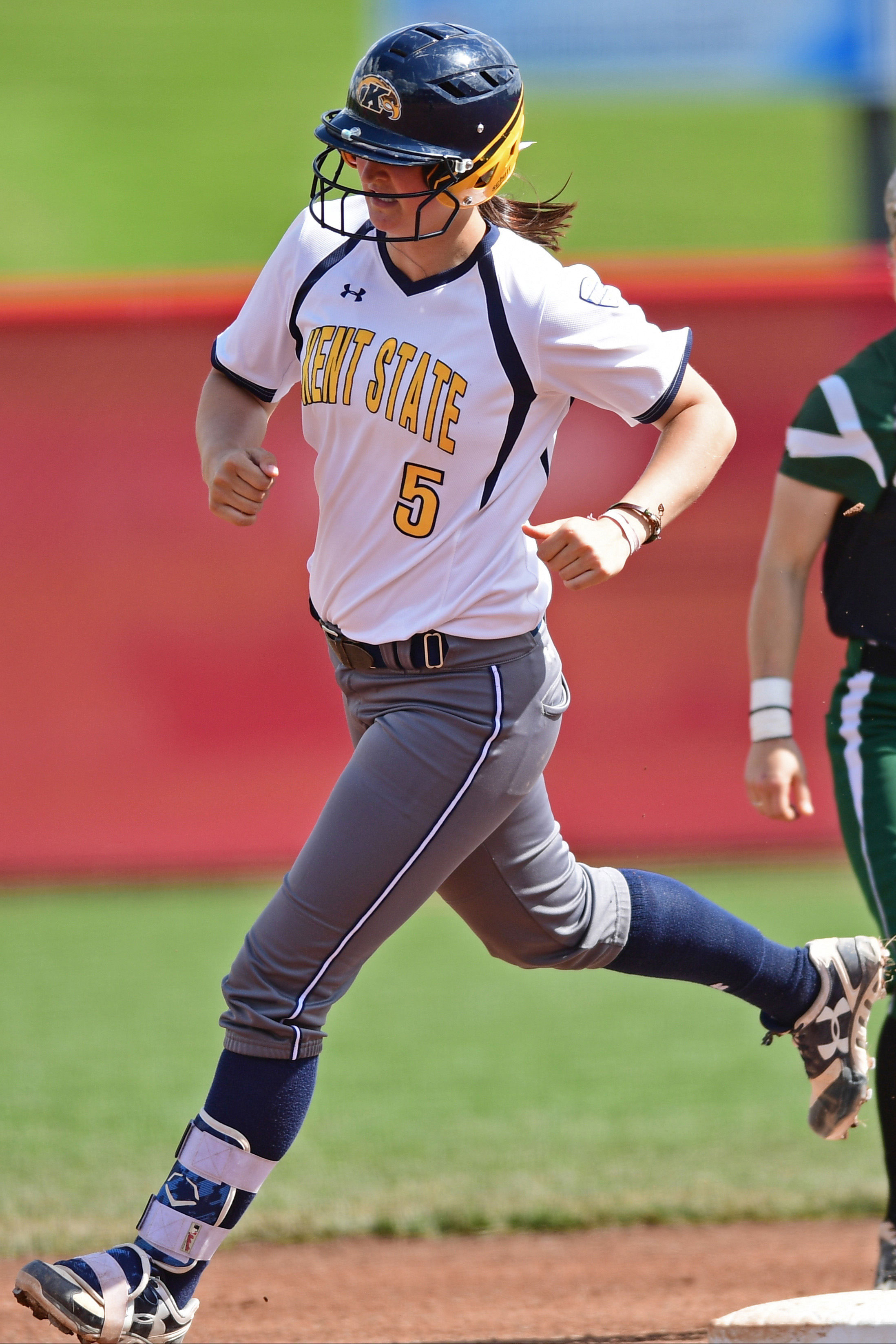 MAC Tournament MVP Ronnie Ladines runs the bases after hitting a two-run home run in the first inning of the final 2017 MAC Softball Tournament game.