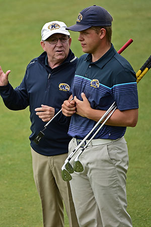 Herb Page (left), head coach of the Kent State men's golf team, gives some advice to sophomore Bjarki Petursson (right) during the 2017 MAC Men's Golf Championship. Page was later named the 2017 MAC Coach of the Year.
