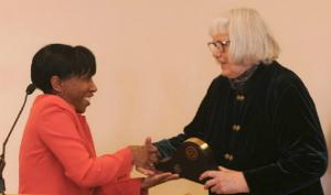 Dr. Brown presents Trailblazer Award to Dr. Noll