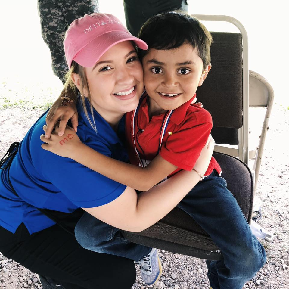 Erica Dovin Poses With a Patient In Honduras