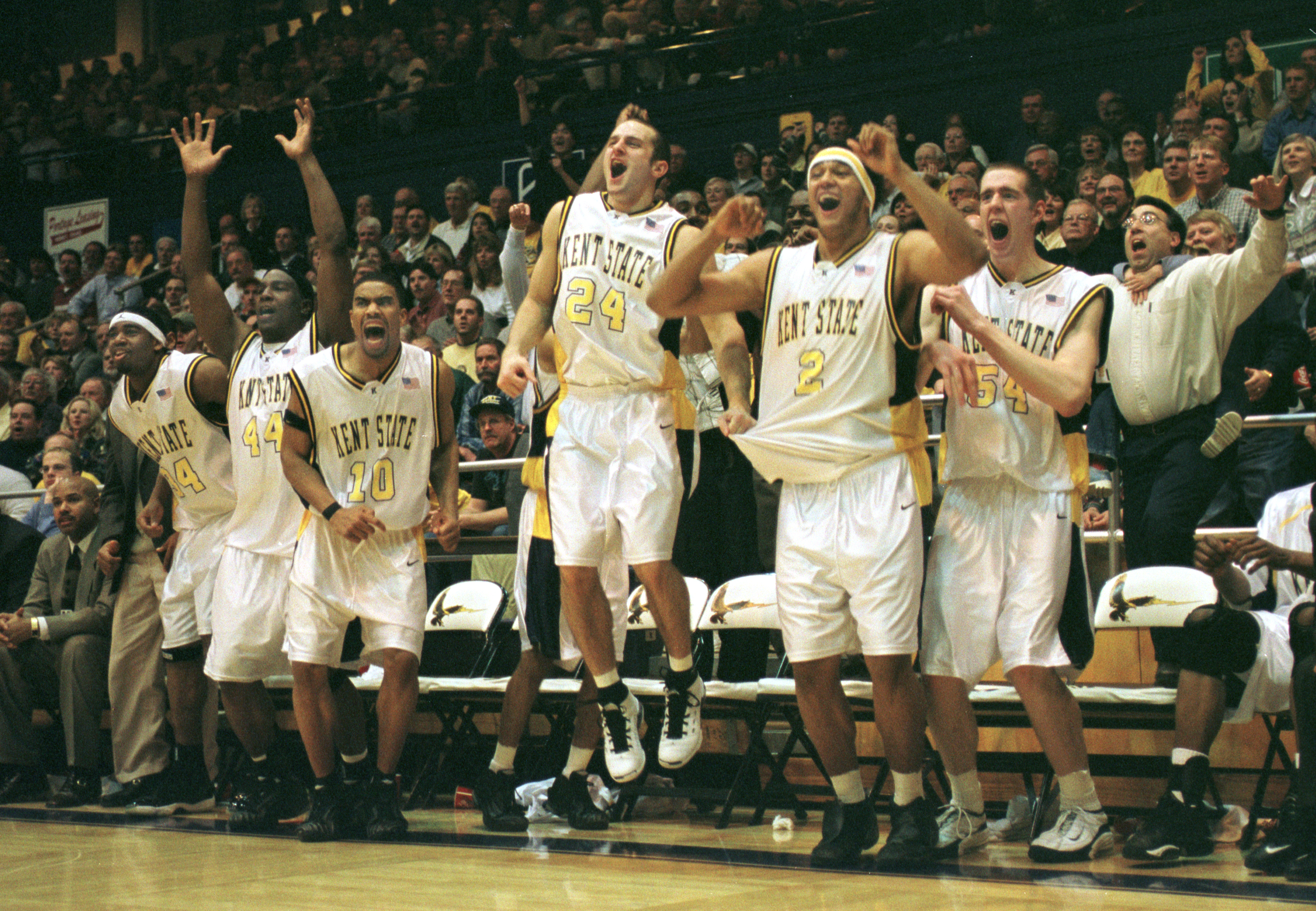 Bryan Bedford (34), Antonio Gates (44), Demetric Shaw (10), Trevor Huffman (24), Nate Gerwig (2) and John Edwards (54) celebrate a win at the M.A.C. Center during the 2001–02 season.