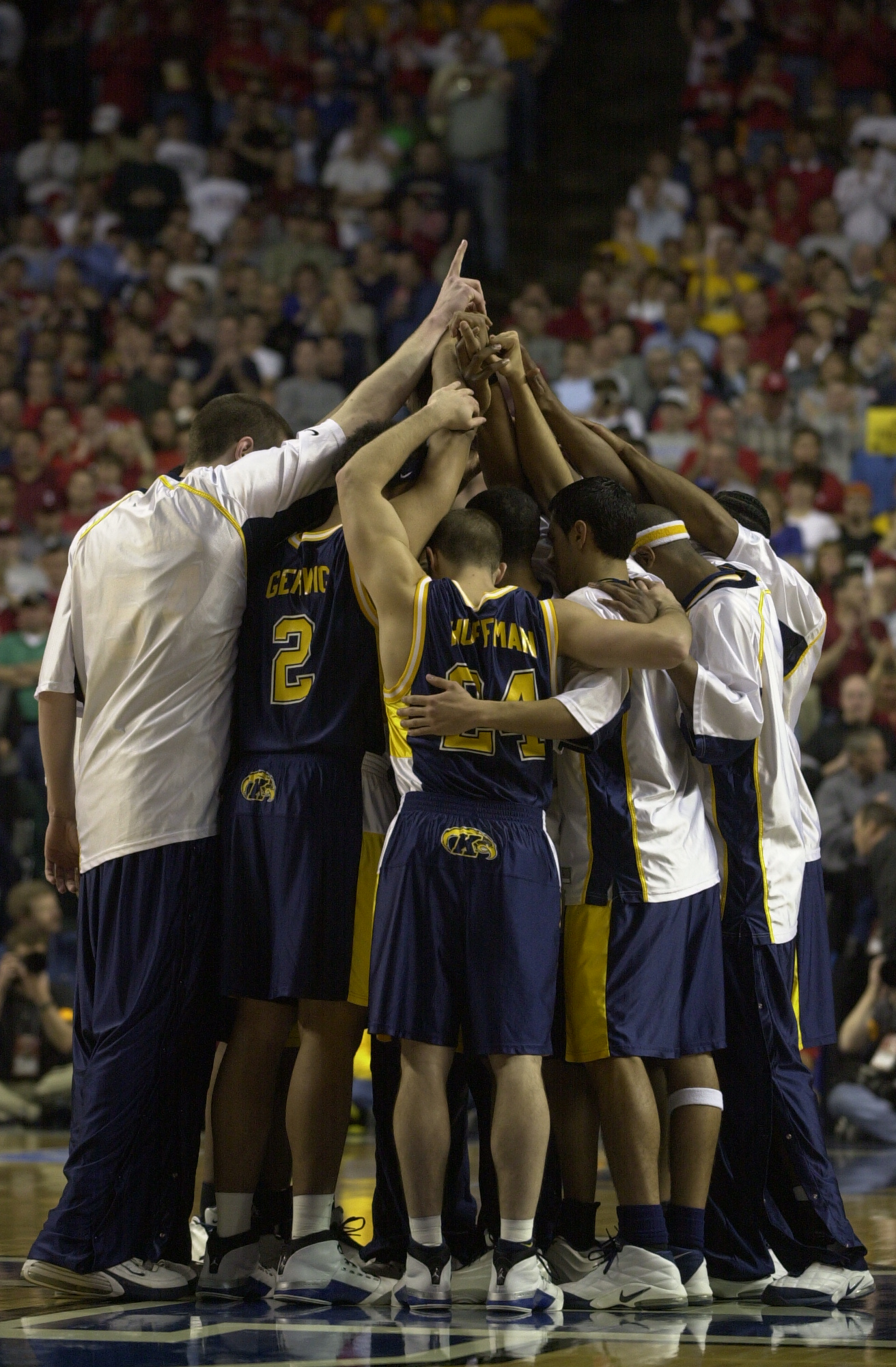 The Golden Flashes huddle prior to their March 23, 2002 Elite Eight game against Indiana at Rupp Arena in Lexington, Kentucky. Photos courtesy Kent State Athletics.
