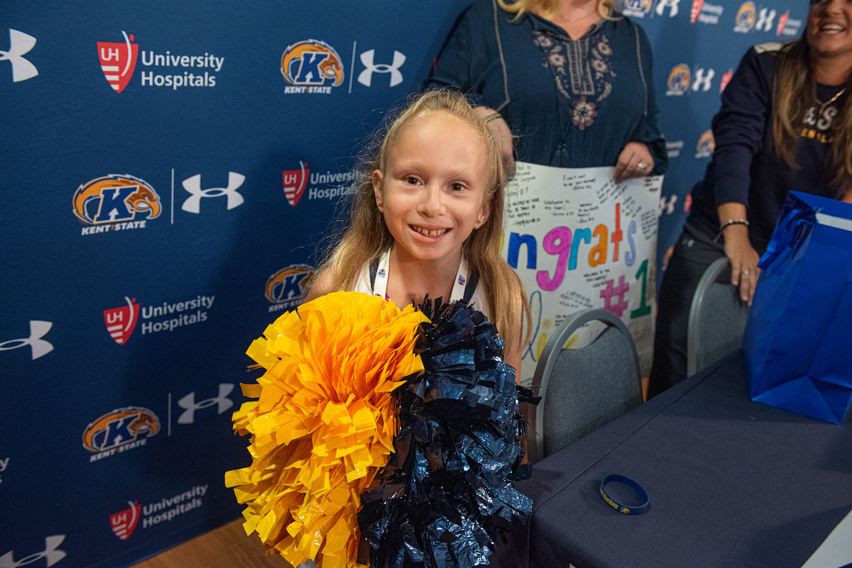 Mary Alice is a also a cheerleader and got to try the pom poms the Kent State cheerleaders use.