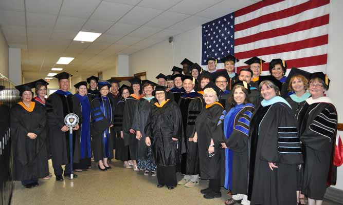 Kent State Salem faculty members get ready to file into commencement ceremonies.