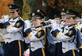 Members of the Homecoming parade marching band perform  along Main Street during Homecoming.