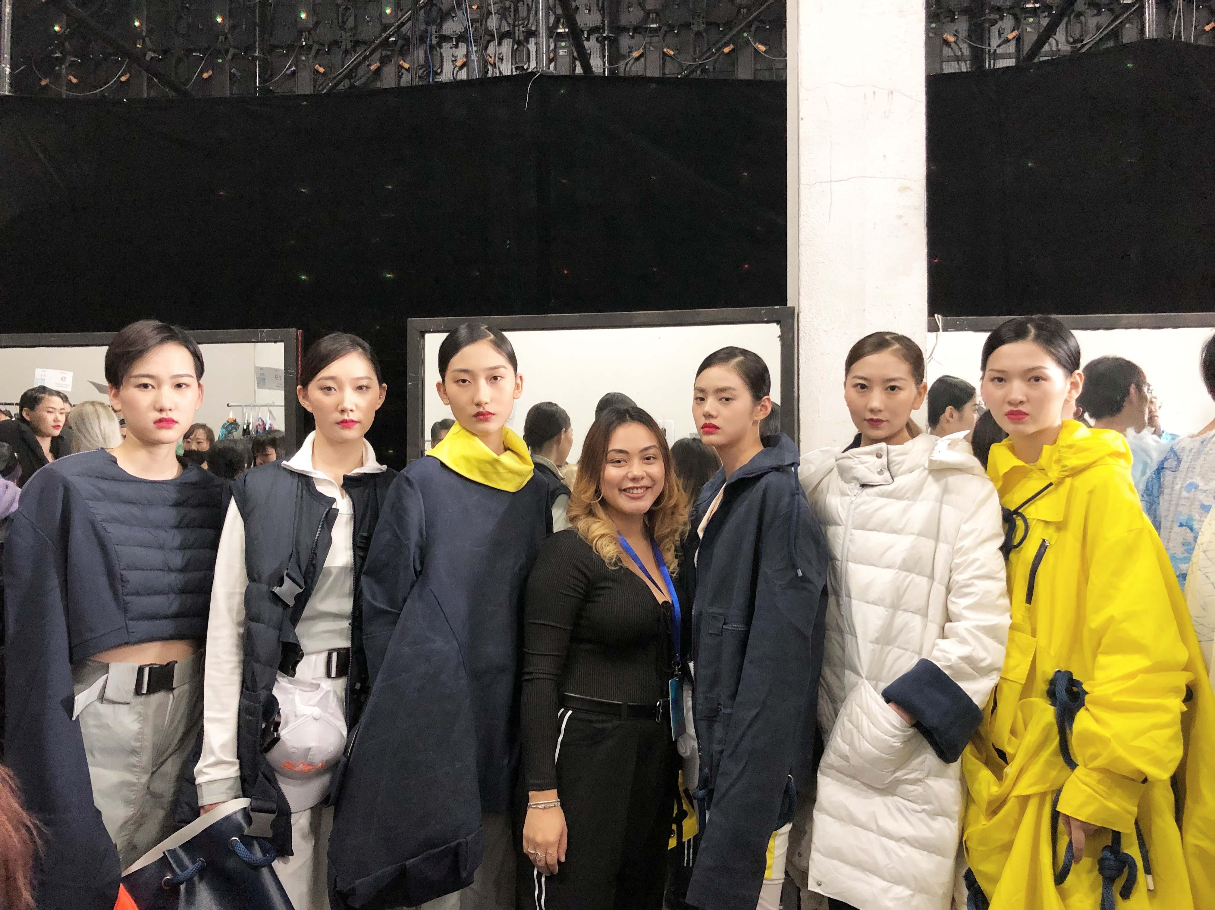 Rojas posing with models at IYDC in China