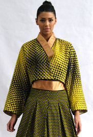 """Kim Hahn and Jihyun Kim, associate professors of fashion merchandising at Kent State University, collaborated to create the award-winning garment """"Amber Refraction"""" that is pictured above. They drew inspiration from the traditional Korean style of Hanbok, while also incorporating an image manipulated in Adobe Photoshop."""