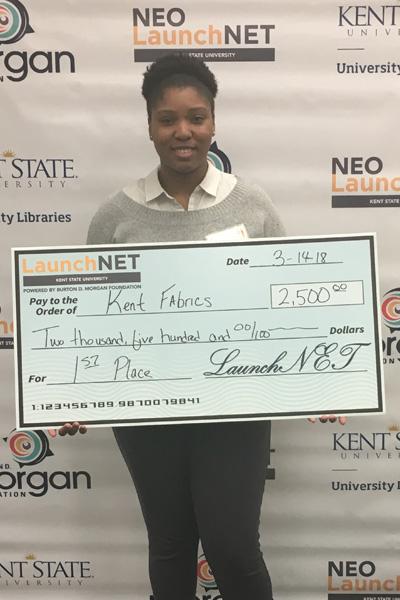 LaunchNet Olympics Winner Symone Baskerville holding her winning check for $2,500