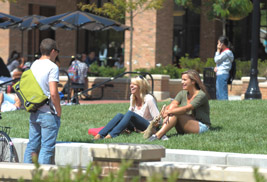 Kent State students relax in the sun at the Risman Plaza on the Kent Campus
