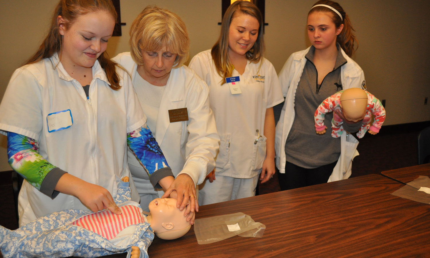 Learning infant CPR with Jan Peterson at nursing boot camp