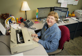 Linda Harsh, clerical specialist at Kent State University at Stark, began her career with the university in 1966. Harsh plans to retire this December. (Photo credit: Mike Rich)