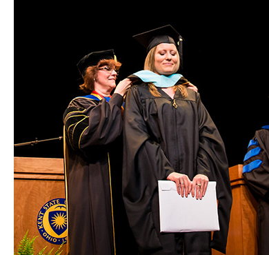 A master's degree graduate is conferred at Kent State Stark's commencement