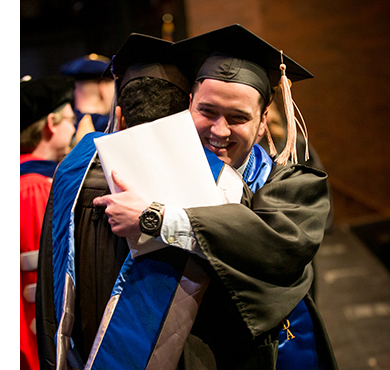 A Kent State Stark graduate receives his diploma