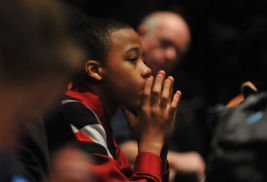 """A young student watches a presentation intently during a previous Kent State University Martin Luther King Jr. celebratory event. This year's celebration, themed """"Honor the Dream,"""" will take place on Jan. 23."""