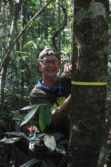M. Norconk measuring the diameter of a small tree.