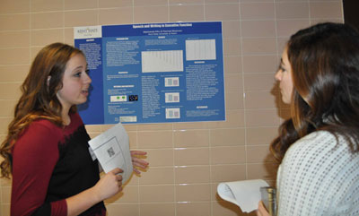 Mackenzie Kiko outlines her research project, Speech Writing and Executive Function, to judge Kelly Dragomir.