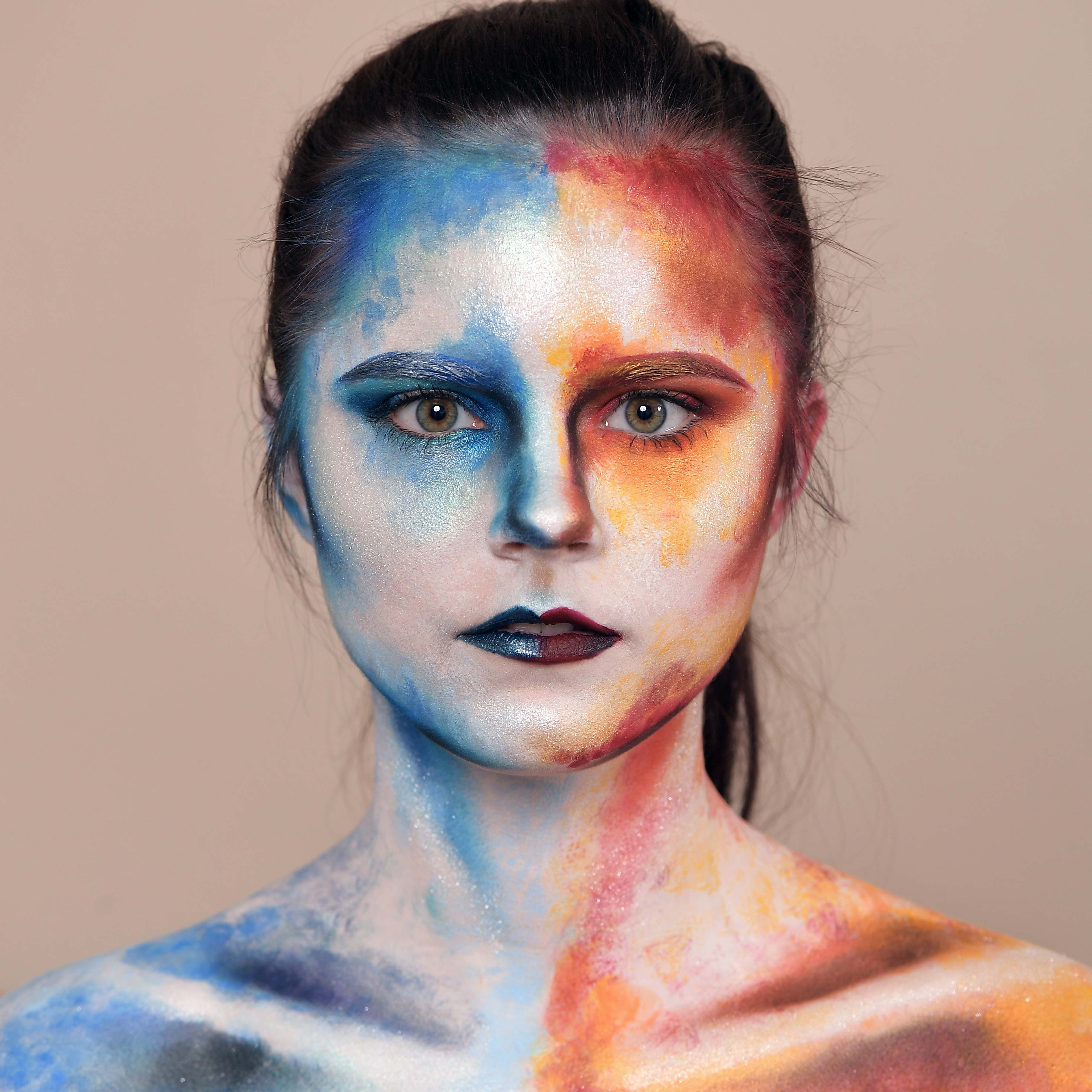 The final product after Carrie Esser uses warm and cool colored, water-based body paint on a friend.