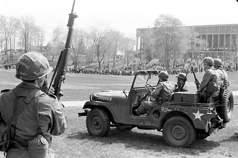 Army jeep and soldier in the commons May 4, 1970