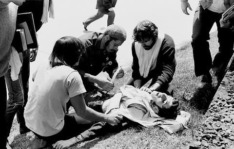 Wounded Kent State student John Cleary is attended to by other students, who helped save his life. (Photo courtesy of Kent State University)