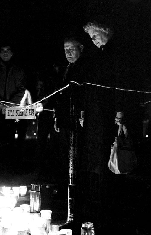 A vigil is held beside Bill Schroeder's spot