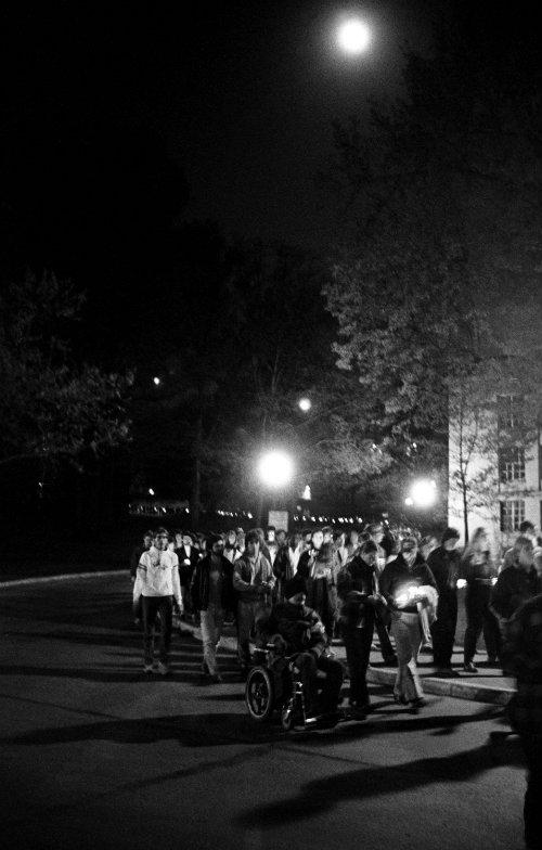 Students hold a vigil walk