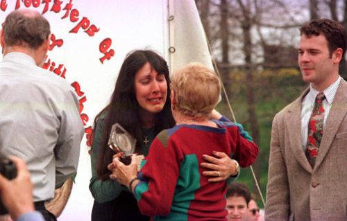 Ms. Vecchio, a survivor, hugs another woman