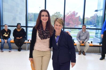 Erin Michael-McLaughlin with President Beverly Warren