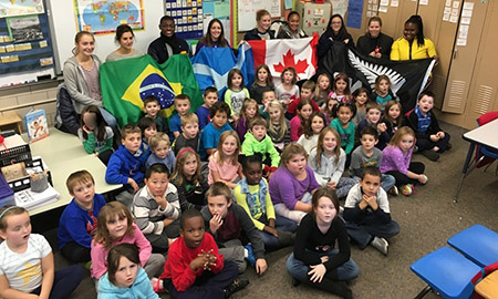 A group of Kent State University international student-athletes representing eight different countries visited first graders at Woodland Elementary School.