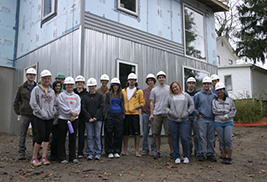 Kent State University students from this year's fourth-year design studio pose for a photo with the owner of the home (fifth from right), which they helped design.