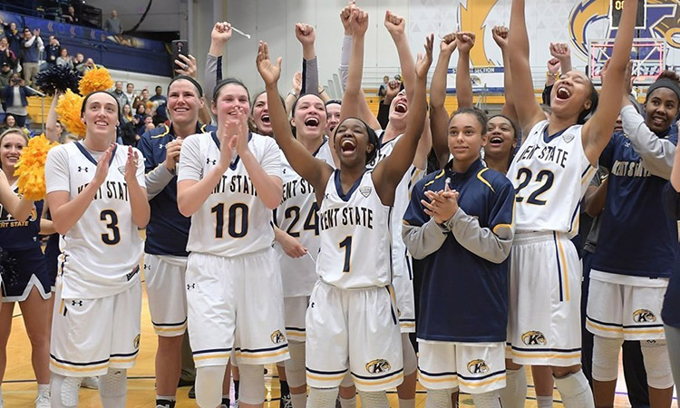 The Kent State women's basketball team celebrates after a game.