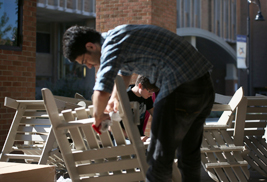 Kent State University student members of Net Impact assemble recycled lumber chairs that were subsequently placed at several locations around the Kent Campus. Net Impact is a nonprofit organization that promotes sustainability.