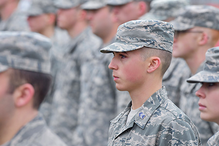 Members of the Kent State University ROTC stand at attention during the playing of the Armed Forces Medley, part of the university's annual observance of Veterans Day.