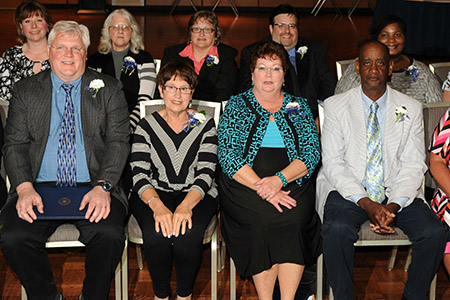 Each year, Kent State University honors employees who have dedicated 20 years of continuous service to Kent State. Pictured are members of the 2015 class of the 20-Year Club.