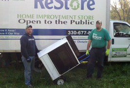Workers from ReStore salvage appliances and equipment from Allerton Apartment buildings, which are at the end of their life cycle