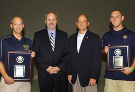 Kent State Baseball Head Coach Scott Stricklin, Provost  Todd Diacon, Director of Athletics Joel Nielsen, and Golden Flashes baseball team member Jason Bagoly pose for a photo after being honored by the NCAA for earning a Public Recognition Award, based on the baseball team's most recent multiyear Academic Progress Rate (APR).