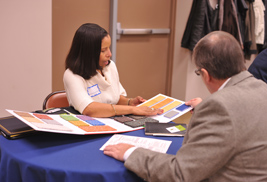 Teresa Golden, president of Environmental Flooring Group, LLC, meets with a representative from Kent State's Procurement Department