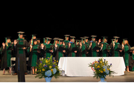Graduating podiatrists from the Ohio College of Podiatric Medicine take the Podiatric Physician's Oath administered by Dr. Richard A. Ransom, former member of OCPM's Board of Trustees.