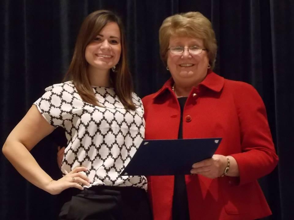 Nicole Sandrella receives the Milton I. Wick Memorial and Dr. Rick Smith Book Award scholarships from Dean Wanda Thomas.