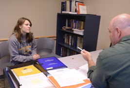 A Kent State University student meets with her advisor. The university is implementing Required Advising to support student success.