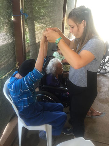 Mary Kenney working with a resident to improve range of motion
